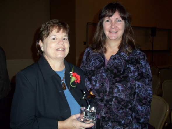 Jeanne Sydenstricker (left) with LEAP Executive Director Melanie Hogan after receiving the Most Treasured Volunteer Award from the Center for Community Solutions.