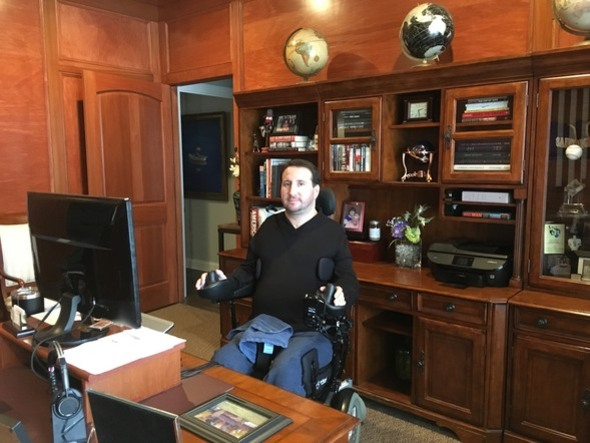 Photo of Scott Fedor, Vice President of LEAP's board, sitting behind his desk at his office.
